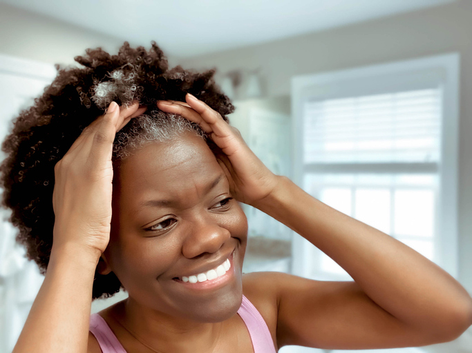 Woman Pulls Hair Back After Washing